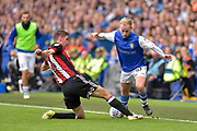 Sheffield United midfielder Chris Basham (6) tackles Sheffield Wednesday midfielder Barry Bannan (10)  during the EFL Sky Bet Championship match between Sheffield Wednesday and Sheffield Utd at Hillsborough, Sheffield, England on 24 September 2017. Photo by Adam Rivers.