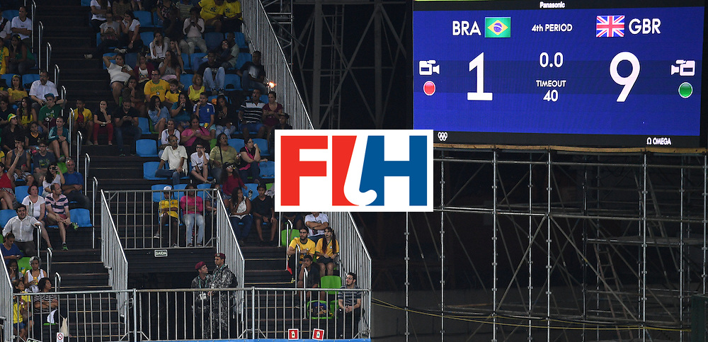 Spectators look on after the men's field hockey Brazil vs Britain match of the Rio 2016 Olympics Games at the Olympic Hockey Centre in Rio de Janeiro on August, 9 2016. / AFP / MANAN VATSYAYANA        (Photo credit should read MANAN VATSYAYANA/AFP/Getty Images)