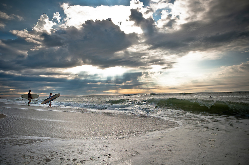 Surfers early in the morning at Gilgo beach, New York