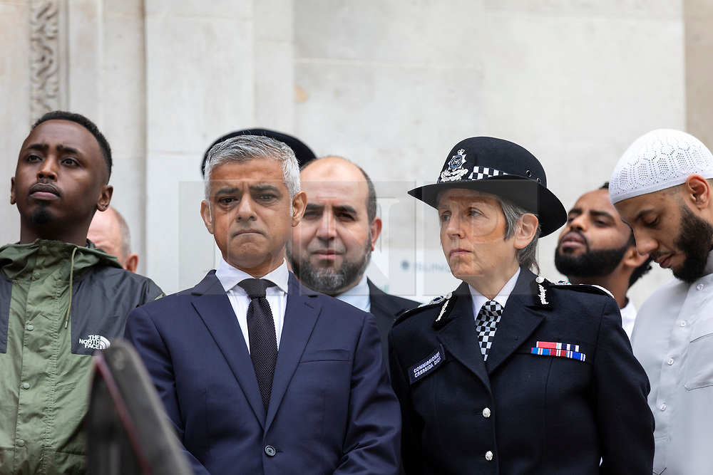 © Licensed to London News Pictures. 19/06/2018. London, UK. Mayor of London Sadiq Khan (2-L) and Met Police Commissioner Cressida Dick (4-L) join politicians, councillors, local faith and community leaders, and emergency services workers for a minute's silence on the steps of Islington Town Hall to mark the first anniversary of the Finsbury Park Attack. Photo credit: Rob Pinney/LNP