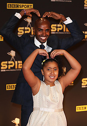 Mo Farah and daughter Rihanna arriving at the BBC Sports Personality of the Year awards in London, Sunday, 16th December 2012.  Photo by: Stephen Lock / i-Images