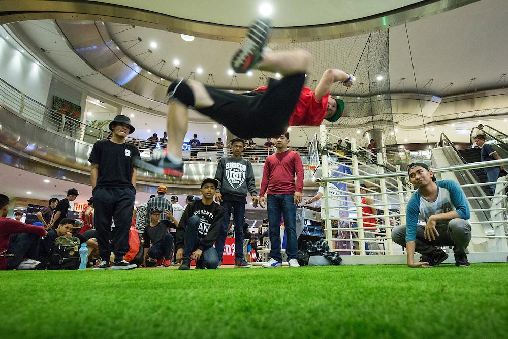 Asia, Malaysia, Kuala Lumpur, Break dancers practice inside massive shopping mall at Bukit Bintang