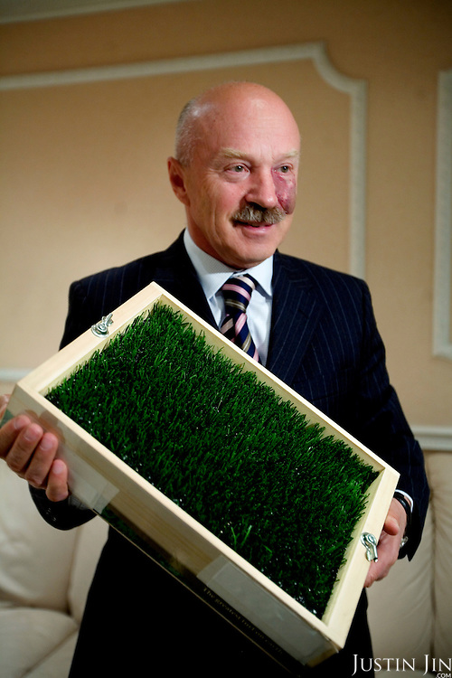 Vladimir Aleshin, General Director of the Luzhniki Olympic Complex, holds a piece of artificial turf that covers the Luzhniki stadium. England will play Russia in October 2007 in the Euro 2008 match on this turf.