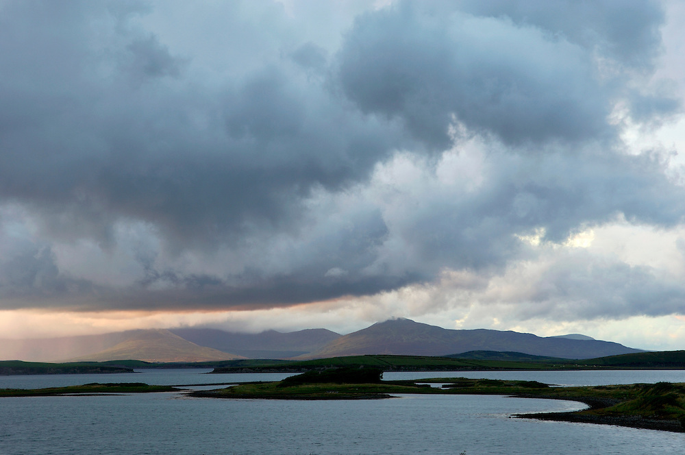North over islands of Clew Bay to the Nephin Beg mountains, County Mayo, Ireland. Evening rain-clouds arrive from the Atlantic.