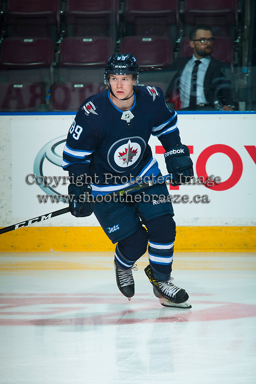 PENTICTON, CANADA - SEPTEMBER 8: Tyler Boland #89 of Winnipeg Jets warms up against the Vancouver Canucks on September 8, 2017 at the South Okanagan Event Centre in Penticton, British Columbia, Canada.  (Photo by Marissa Baecker/Shoot the Breeze)  *** Local Caption ***