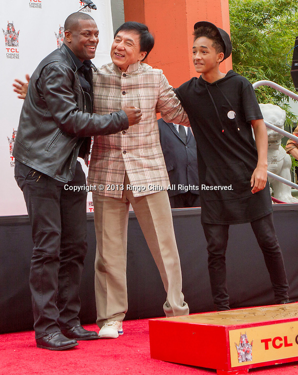 Actor Jackie Chan poses with Chris Tucker, left, and Jaden Smith, right,  at his hand and footprint ceremony in front of the TLC Chinese Theatre in Hollywood, California on June 6,2013. Chan became the first ever Chinese star immortalized in cement in Hollywood. (Photo by Ringo Chiu/PHOTOFORMULA.com)