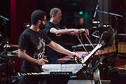 Brooklyn, NY - 20 January 2015. The dress rehearsal of Sufjan Stevens' Round-Up, with slow motion film of the Pendleton, Oregon Round-Up by Aaron and Alex Craig, music performd by Sufjan Stevens and Yarn/Wire. Musicians (L to R) Russell Greenberg and Ian Antonio.