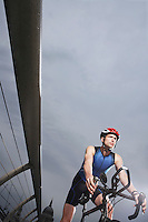 Cyclist riding on foot bridge low angle view
