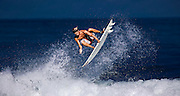 "SHOT 1/22/10 10:42:59 AM - Pro surfer Adan Hernandez of Sayulita, Mexico catches air off a wave in Sayulita, Mexico. Sayulita is a small fishing village about 25 miles north of downtown Puerto Vallarta in the state of Nayarit, Mexico, with a population of approximately 4,000. Known for its consistent river mouth surf break, roving surfers ""discovered"" Sayulita in the late 60's with the construction of Mexican Highway 200. In recent years, it has become increasingly popular as a holiday and vacation destination, especially with surfing enthusiasts and American and Canadian tourists. (Photo by Marc Piscotty / © 2009)"