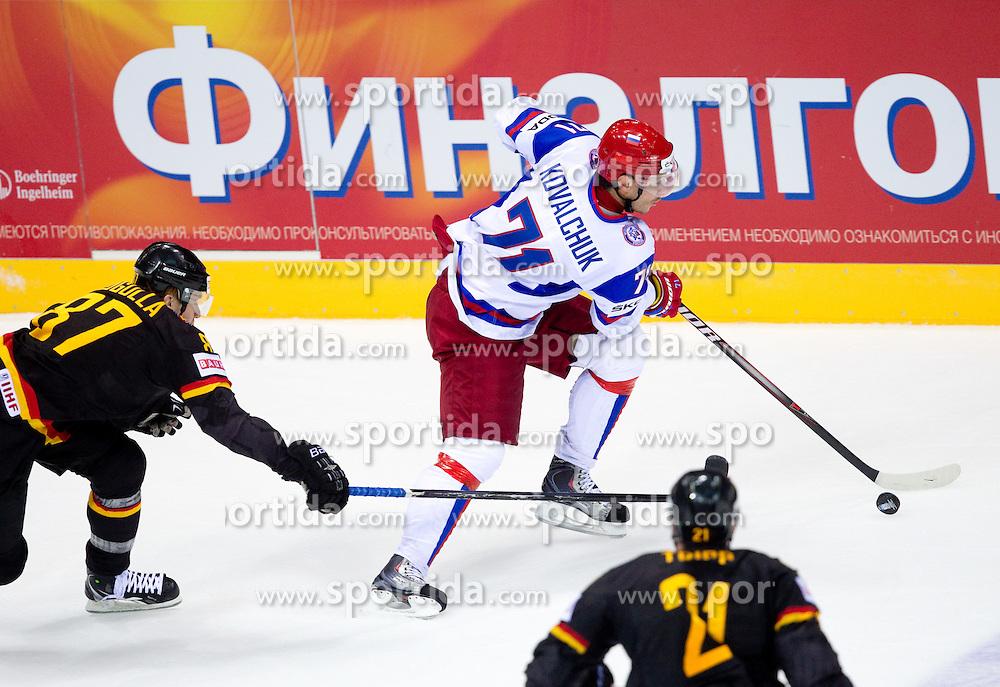 Philip Gogulla of Germany vs Ilya Kovalchuk of Russia during ice-hockey match between Germany and Russia of Group A of IIHF 2011 World Championship Slovakia, on April 29, 2011 in Orange Arena, Bratislava, Slovakia. (Photo By Vid Ponikvar / Sportida.com)