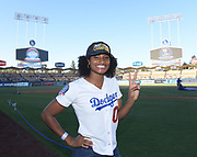 Jun 13, 2018; Los Angeles, CA, USA; Anna Cockrell poses before a MLB game between the Texas Rangers and the Los Angeles Dodgers at Dodger Stadium. Cockrell ran the second leg of the Southern California Trojans women's 4 x 400m relay team that won the NCAA title to clinch the national team championship.