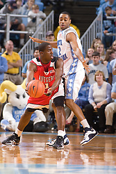 28 December 2006: Rutgers guard (1) Marquis Webb pressured by guard (2) Wayne Ellington during a 87-48 Rutgers Scarlet Knights loss to the North Carolina Tarheels, in the Dean Smith Center in Chapel Hill, NC.<br />