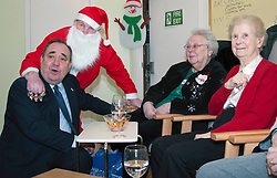 First Minister Alex Salmond, accompanied by Santa Clause (Arthur Martin), visited the Dean Club in Stiockbridge Edinburgh today to distribute Christmas presenets to the residents.  (c) GER HARLEY | StockPix.eu