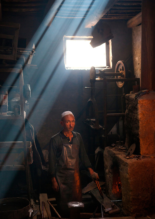 Blacksmith in his workshop, Xinjiang Uyghur autonomous region, China.