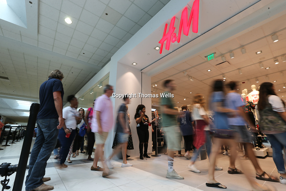 Shoppers hurry into the new H&M at The Mall at Barnes Crossing following it's grand opening Thursday.
