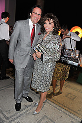 JOAN COLLINS and PERCY GIBSON at a private view of Ballgowns: British Glamour Since 1950 at the V&A museum, London on 15th May 2012.