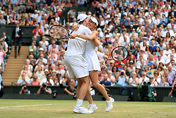 Martina Hingis and Jamie Murray celebrate victory in the mixed doubles final against Heather Watson and Henri Kontinen on day thirteen of the Wimbledon Championships at The All England Lawn Tennis and Croquet Club, Wimbledon.