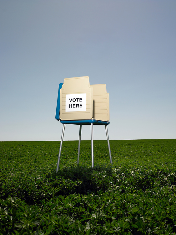 Empty voting booth in crop field.