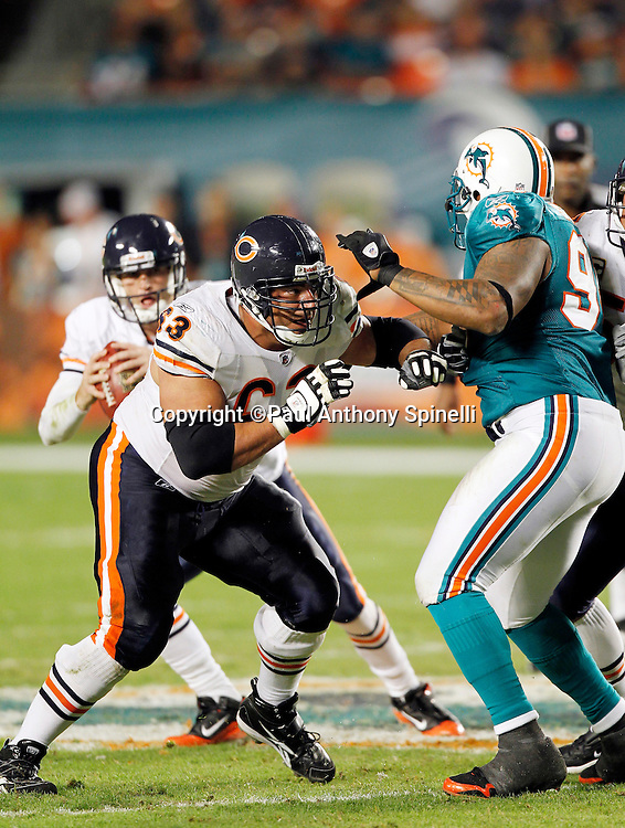 Chicago Bears center Roberto Garza (63) blocks Miami Dolphins defensive end Randy Starks (94) during the NFL week 11 football game against the Miami Dolphins on Thursday, November 18, 2010 in Miami Gardens, Florida. The Bears won the game 16-0. (©Paul Anthony Spinelli)