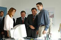 """24 JUN 2003, BERLIN/GERMANY:<br /> Edelgard Bulmahn, SPD, Bundesbildungsministerin, Reinhard Uppenkamp, Vorstandsvorsitzender Berlin Chemie AG, Gerhard Schroeder, SPD, Bundeskanzler, im Gespraech mit einem Auszubildenden (v.L.n.R.),  waehrend einem Besuch der Berlin-Chemie AG im Rahmen einer Sitzung des Runden Tisches """"Ausbilden jetzt - Erfolg braucht alle"""", Berlin-Chemie AG<br /> IMAGE: 20030624-01-005<br /> KEYWORDS: Gerhard Schröder"""