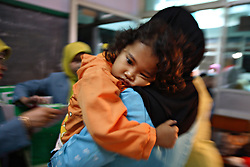 A young girl is comforted after being circumcised in Bandung, Indonesia on April 23, 2007. The families of 248 girls were given money to have their children circumcised in a mass circumcision celebration timed to honour the Prophet Mohammed's birthday. While religion was the main reason for circumcisions, it is believed by some locals that a girl who is not circumcised would have unclean genitals after she urinates which could lead to cervical cancer. It is also believed if one prays with unclean genitals their prayer won't be heard. The practitioners used scissors to cut the hood and tip of the clitoris. The World Health Organization has deemed the ritual unnecessary and condemns such practices.