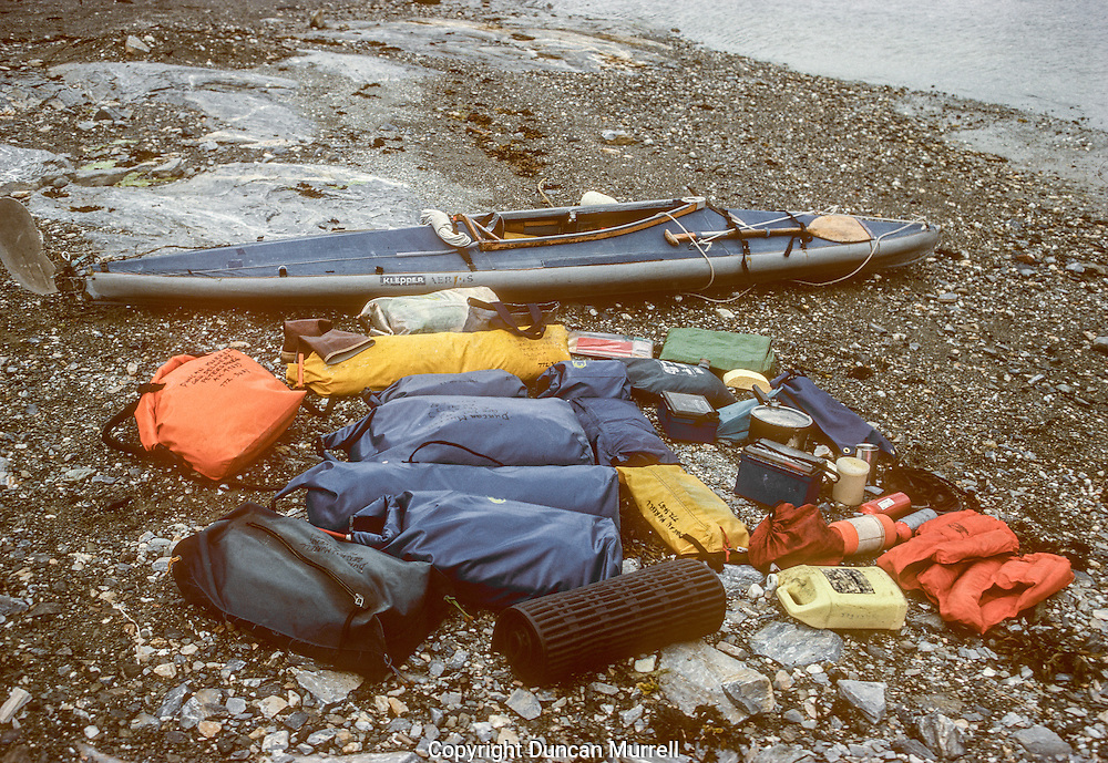 "My partner and I eventually separated and I had one last fantastic summer alone cruising around Southeast Alaska with ""Avalon"" and my Klepper folding kayak. After that I just used my kayak and took everything that I needed to travel around with the humpback whales and camp out for many weeks alone in the Alaskan wilderness. It became a big challenge to be able to pack so much food and equipment in drybags into and onto my small folding kayak; everything had its place in the intricate jigsaw puzzle. Packing the kayak was always a chore but a necessary one to enable me to have so much freedom all summer. I developed a good system for taking the right dried food along with a certain amount of fresh food that could be hung up in the trees and eaten in the right order. That was supplemented with a growing knowledge of wild food that could be harvested from the beaches and the forest."