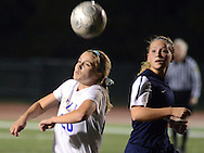 NEWTON, PA - NOVEMBER 4: Villa Joseph Marie's Casey Gilchrist #20 heads the ball as she is chased by Conrad Weiser's Christina Kohler #3 in the first half of the PIAA Class AA first-round girls soccer playoff game November 4, 2014 in Newtown, Pennsylvania.  (Photo by William Thomas Cain/Cain Images)