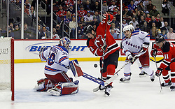 February 1, 2008; Newark, NJ, USA; New Jersey Devils right wing David Clarkson (23) looks for a rebound after a save by New York Rangers goalie Henrik Lundqvist (30) during the second period at the Prudential Center in Newark, NJ.