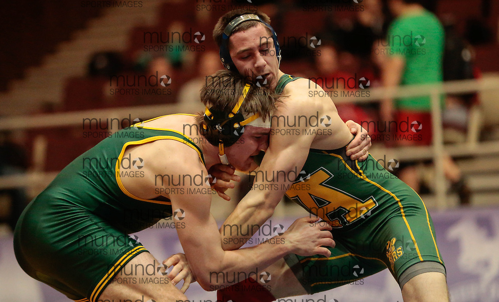 London, Ontario ---2013-03-02--- Jacob Luczak of The University Of Regina takes on Coleman Brinker of The University Of Alberta in the men's 76 KG 5th/6th match at the 2012 CIS Wrestling Championships in London, Ontario, March 02, 2013. .GEOFF ROBINS/Mundo Sport Images