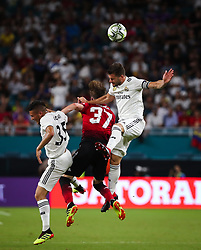 July 31, 2018 - Miami Gardens, Florida, USA - Real Madrid C.F. defender Nacho Fernandez (6) (right) leaps to head the ball above Manchester United F.C. defender James Garner (37) (center) and Real Madrid C.F. midfielder Oscar Rodriguez (35) (left) during an International Champions Cup match between Real Madrid C.F. and Manchester United F.C. at the Hard Rock Stadium in Miami Gardens, Florida. Manchester United F.C. won the game 2-1. (Credit Image: © Mario Houben via ZUMA Wire)