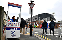 A vendor sells match programmes outside the grounds before the Premier League match at Selhurst Park, London.