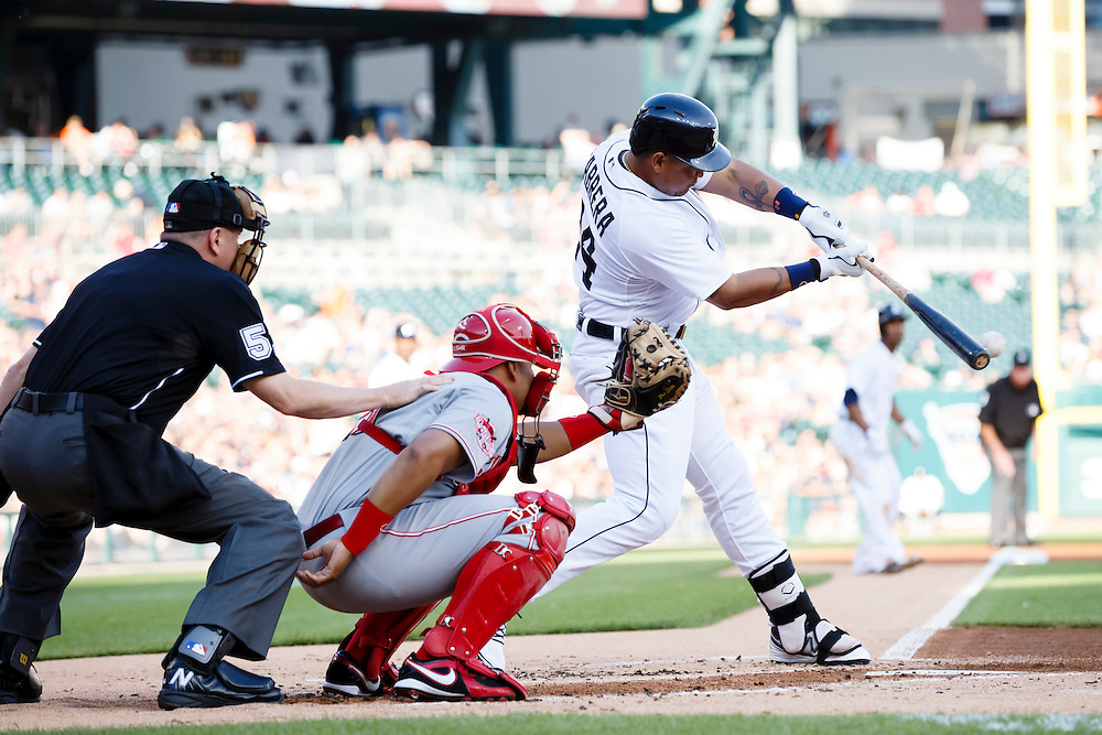Jun 16, 2015; Detroit, MI, USA; Detroit Tigers first baseman Miguel Cabrera (24) hits an RBI single in the first inning against the Cincinnati Reds at Comerica Park. Mandatory Credit: Rick Osentoski-USA TODAY Sports