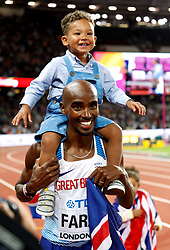File photo dated 04-08-2017 of Great Britain's Mo Farah celebrates with his son Hussein Mo Farah after winning the Men's 10,000m during day one of the 2017 IAAF World Championships at the London Stadium.