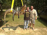 'We're gonna need a bigger boat': Gator hunters break TWO state records with monster catches on the same day including a 727lb reptile hauled in by a UPS worker<br /> <br /> Within a few hours of alligator hunting season opening, the record for the heaviest and longest reptiles to be caught in Mississippi had been set and broken several times.<br /> The first record was set early on Sunday, with a 10ft reptile, weighing 295.3lb, which took the heaviest and longest titles for a female alligator.<br /> Just a few hours later however, first-time hunter Beth Trammell, of Madison, helped haul in a 723.5lb male alligator. Her catch broke the state record, but only for a few hours.<br /> Later in the day UPS worker Dustin Bockman was part of a three-man team who caught a 13ft long, 727lb beast from the Mississippi. <br /> 'We're going to cook it for sure,' he toldGulf Live. 'There's plenty for me and everybody else.'<br /> Alligators had nearly been hunted to extinction in Mississippi in the 1960s but a successful conservation program now means the state needs controlled hunting of the reptiles. <br /> It offers permits to a select number of people each year, who are able to hunt in public waters from August 30 to September 9.<br /> It took Mr Bockman, his brother and a friend, nearly 12 hours to catch the huge gator. <br /> After two hours of trailing it, they got close enough to shoot it with a crossbow, which is where the fight between man and beast began, the Clarion-Ledger reported. <br /> 'He would go to the bottom and sit like a log. You couldn't do nothing with him,' Mr Bockman said. <br /> Compared to what came next, reeling the 727lb beast in was nothing.<br /> <br /> After it was dead, the hunters were faced with the dilemma of how to get the carcass in their boat. It took four hours of tugging before they gave up, and rested their catch on a sandbar as they waited for help. <br /> The three men then waited for more than two hours for reinforcements to arrive. <