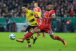 MUNICH, Dec. 21, 2017  Bayern Munich's Arturo Vidal (front R) vies with Dortmund's Raphael Guerreiro (front L) during a German Cup 3rd round match between Bayern Munich and Borussia Dortmund, in Munich, Germany, on Dec. 20, 2017. Bayern Munich won 2-1 and advanced into quaterfinals. (Credit Image: © Philippe Ruiz/Xinhua via ZUMA Wire)