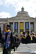 Graduates leave the Eastman Quad at the conclusion of the University of Rochester's Commencement Ceremony on Sunday, May 18, 2014.