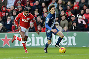 Birmingham City striker Diego Fabbrini escapes the attention of Bristol City defender Mark Little during the Sky Bet Championship match between Bristol City and Birmingham City at Ashton Gate, Bristol, England on 30 January 2016. Photo by Alan Franklin.