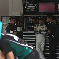 Sprint Cup Series driver Dale Earnhardt Jr. talks with crew members  in the garage at the Daytona International Speedway on February 18, 2011 in Daytona Beach, Florida. (AP Photo/Alex Menendez)