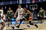 Donald Carey (0) of Siena drives past Leighton Schrand (10) of Xavier during an NCAA college basketball game, Friday, Nov. 8, 2019, at the Cintas Center in Cincinnati, OH. Xavier defeated Siena 81-63. (Jason Whitman/Image of Sport)
