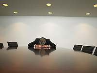 Businessman sleeping at table in conference room