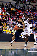 26 November 2005: Dominic James, freshman guard for Marquette University drives past USC's Rocky Trice (10) in the Marquette Golden Eagle 92-89 overtime victory over the University of South Carolina Gamecocks to win the championship at the Great Alaska Shootout in Anchorage, Alaska.