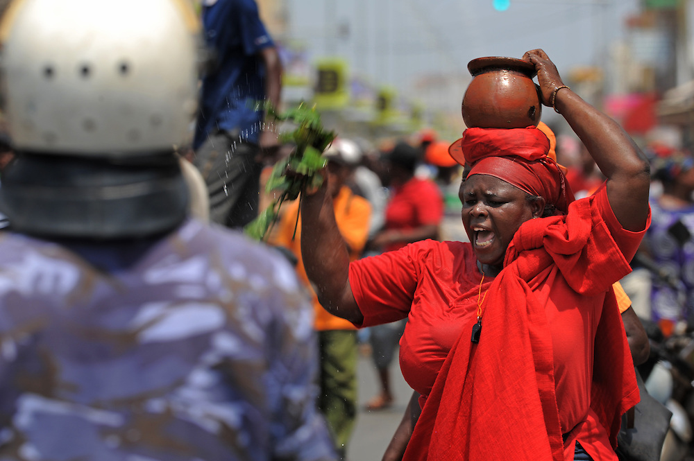 LOME, TOGO  13-02-16   - A woman curses the regime, as  several thousand opposition supporters marched peacefully through the streets of Lome on Saturday, February 16.  Photo by Daniel Hayduk