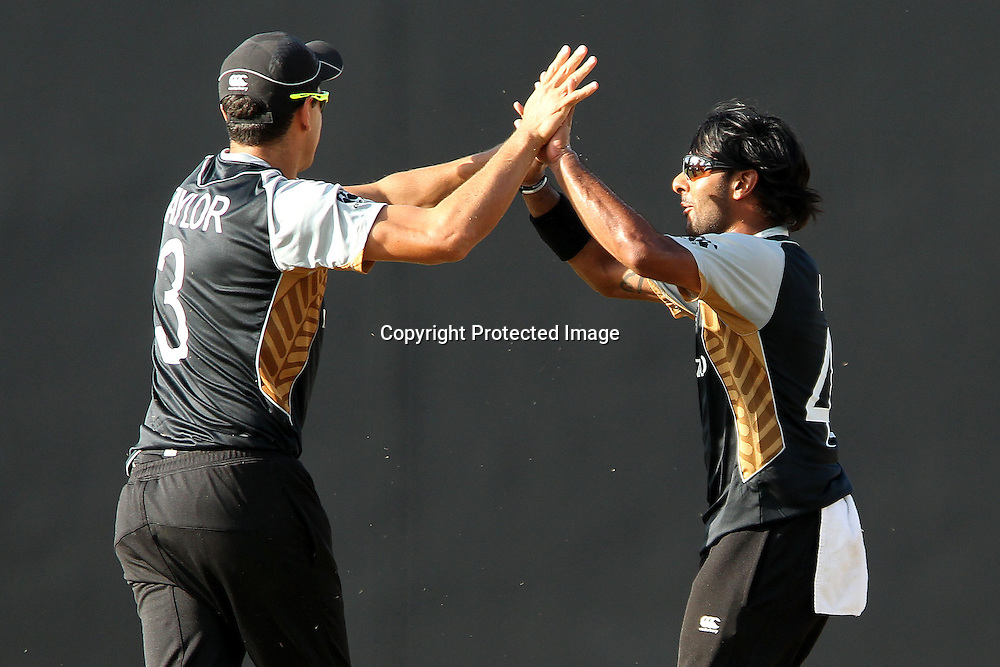Roneel Hira celebrates the wicket of Denesh Ramdin of The West Indies with Ross Taylor (Captain) during the ICC World Twenty20 Super Eights match between The West Indies and New Zealand held at the  Pallekele Stadium in Kandy, Sri Lanka on the 1st October 2012<br /> <br /> Photo by Ron Gaunt/SPORTZPICS/PHOTOSPORT