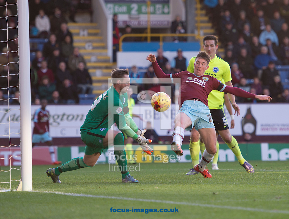 Chris Long of Burnley (2nd right) pokes the ball wide during the Sky Bet Championship match at Turf Moor, Burnley<br /> Picture by Russell Hart/Focus Images Ltd 07791 688 420<br /> 22/11/2015