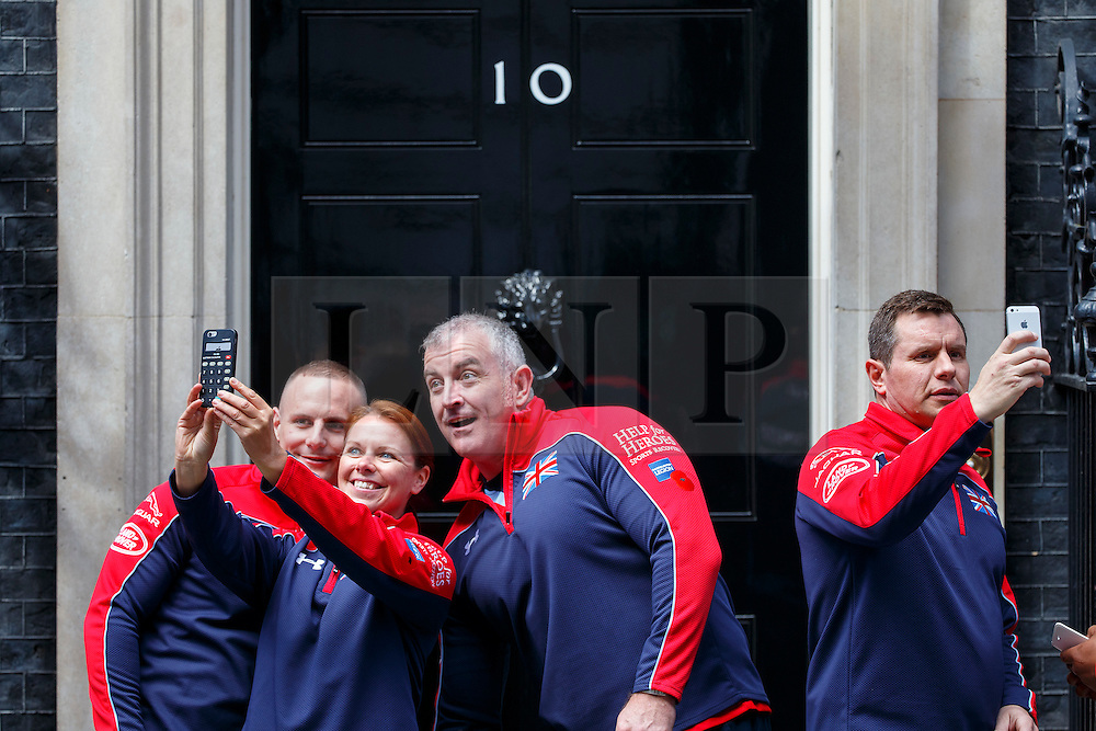 © Licensed to London News Pictures. 27/04/2016. London, UK. Members of the United Kingdom team attending the Invictus Games taking pictures of themselves before meeting Prime Minister David Cameron in Downing Street, London on Tuesday, 27 April 2016. Photo credit: Tolga Akmen/LNP