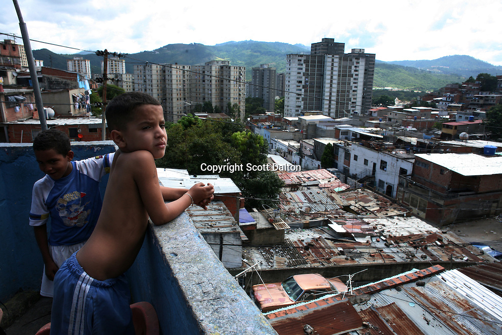 A boy looks out from his rooftop onto El Valle, a heavy pro-Chavez area in Caracas, on Monday, November 27, 2006. (Photo/Scott Dalton)