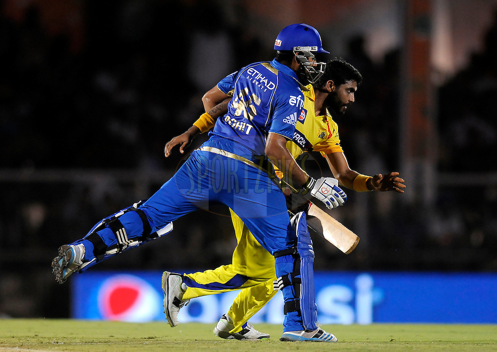 Ravindra Jadeja of The Chennai Superkings collides with Rohit Sharma captain of the Mumbai Indians as he runs to stop a ball during the eliminator match of the Pepsi Indian Premier League Season 2014 between the Chennai Superkings and the Mumbai Indians held at the Brabourne Stadium, Mumbai, India on the 28th May  2014<br /> <br /> Photo by Pal PIllai / IPL / SPORTZPICS<br /> <br /> <br /> <br /> Image use subject to terms and conditions which can be found here:  http://sportzpics.photoshelter.com/gallery/Pepsi-IPL-Image-terms-and-conditions/G00004VW1IVJ.gB0/C0000TScjhBM6ikg