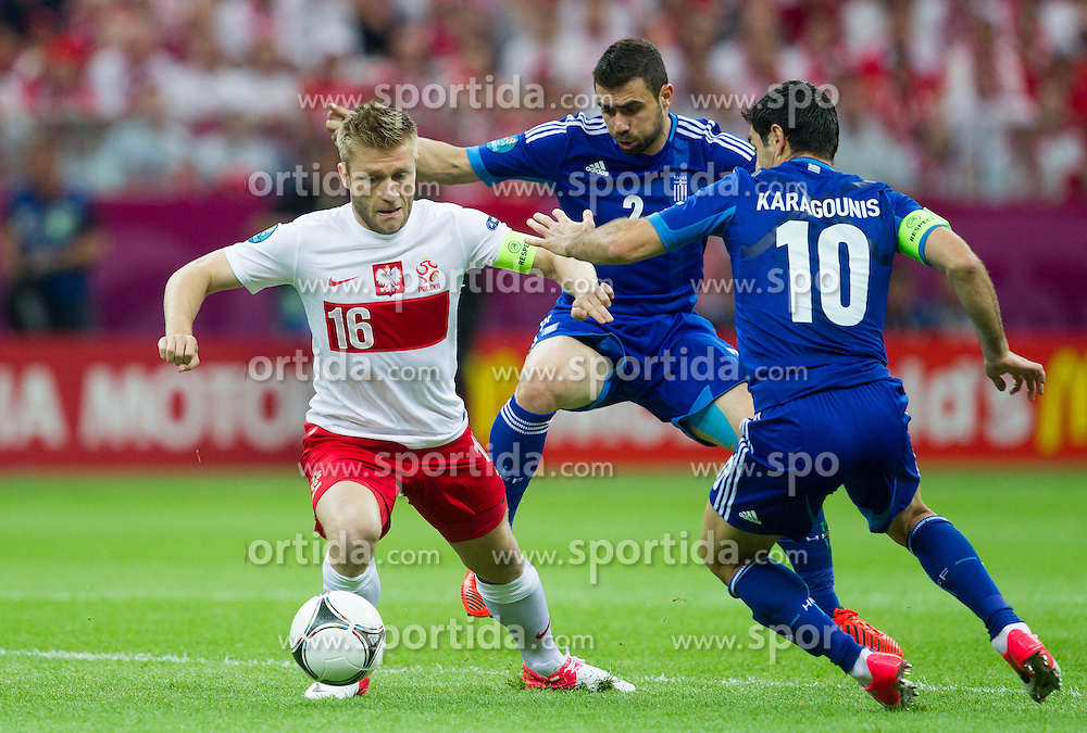 Jakub Blaszczykowski of Poland vs Giannis Maniatis  of Greece and Giorgos Karagounis  of Greece prior to the UEFA EURO 2012 group A match between Poland and Greece at The National Stadium on June 8, 2012 in Warsaw, Poland.  (Photo by Vid Ponikvar / Sportida.com)