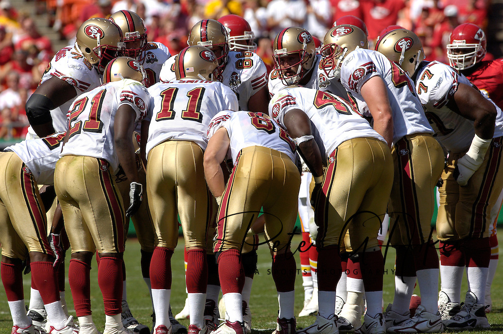 San Francisco 49ers quarterback Alex Smith (11) huddles with his teammates against Kansas City at Arrowhead Stadium in Kansas City, Missouri October 1, 2006.  The Chiefs beat the 49ers 41-0.