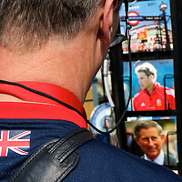 A tourist surverys the racks of postcards depicting PRINCE CHARLES and his son PRINCE WILLIAM in the days leading up to the royal wedding on April 29, 2011 in Westminster Abbey, London, UK.